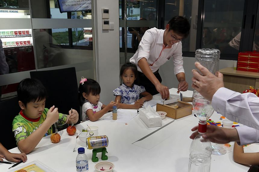 Children learning about science at yesterday's opening of a new building at The Institution of Engineers, Singapore.
