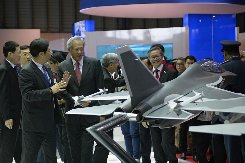 The deal was signed on the sidelines of the airshow, attended by Defence Minister Ng Eng Hen (fourth from left) - seen here at the Boeing booth yesterday.