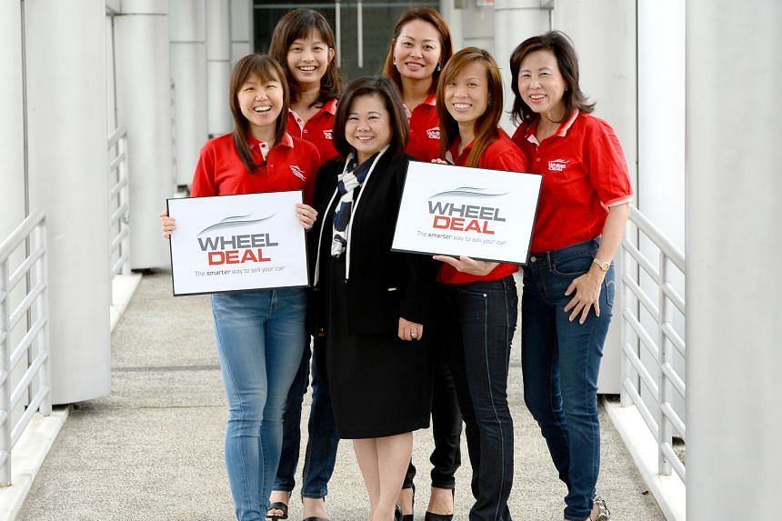 SPH Print Classified Call Centre senior advertisement sales director Florence Tan (in black) with the Wheel Deal team. Since its launch in November last year, the platform - which has about seven used car dealers in its network - has received over 3,