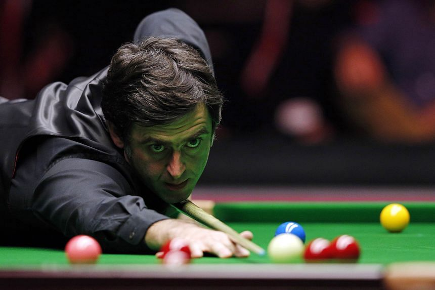 England's Ronnie O'Sullivan plays a shot during the Masters Snooker final last month. On Monday, the five-time world champion was on the brink of the 14th maximum break of his career, but opted against it because he said the £10,000 (S$20,200) prize