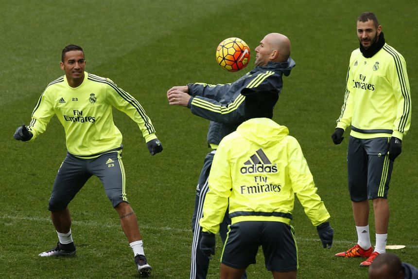 In his Champions League managerial debut, Real Madrid coach Zinedine Zidane (centre, with ball) will be hoping his team's unbeaten run under his stewardship will continue as they take on Roma in the first leg of their Champions League last-16 clash t