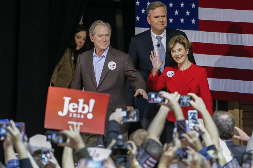 US Republican presidential candidate Jeb Bush (centre) at a campaign event with his brother, former US president George W. Bush, and former first lady Laura Bush in North Charlestonon Monday. South Carolina Republicans vote in their primary this Satu