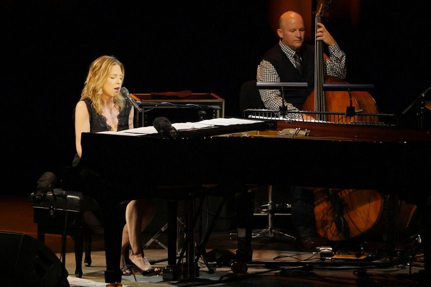 Diana Krall shows great synergy with her musicians, including bassist Dennis Crouch.