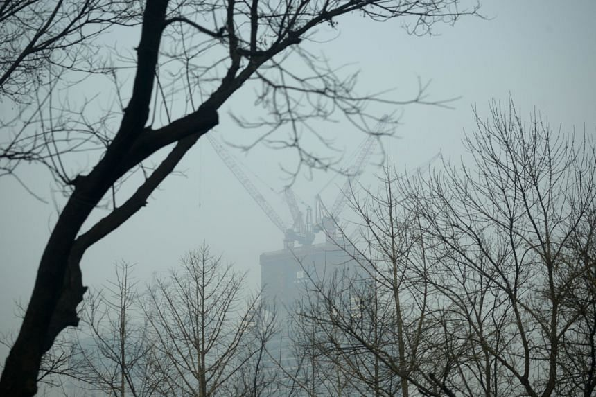 "Heavy smog in Beijing during one of the city's three ""airpocalypses"" late last year. The authorities insist, however, that air quality in the Chinese capital has improved over the past two years."