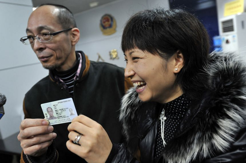A Japanese couple collecting their green cards at an immigration office in Ganzhou, Jiangxi province. More than 7,300 foreigners had obtained permanent residency in China by 2013, but that is but a fraction of the 600,000 foreigners there. China hope