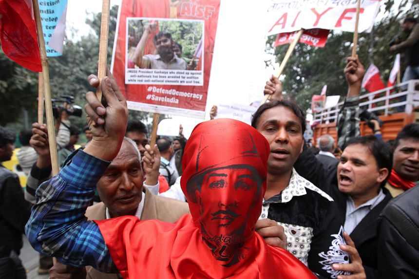 An activist wearing the mask of Indian revolutionary Bhagat Singh joining JNU students and their supporters in a protest march against the arrest of student leader Kanhaiya Kumar in New Delhi on Thursday. Top scholars, including American philosopher