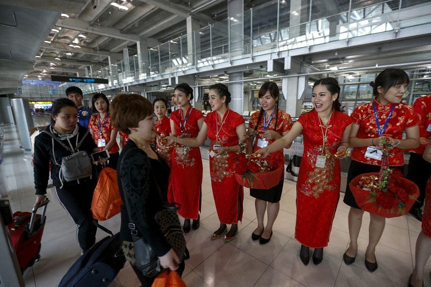 Visitors from China arriving at Bangkok's Suvarnabhumi Airport. Thailand is under pressure to improve its aviation standards after the US Federal Aviation Administration downgraded its safety ratings in December last year.