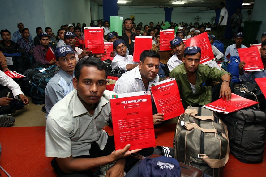 Bangladeshi workers waiting to be picked up by their agents and employers at the Immigration holding area at KL International Airport.