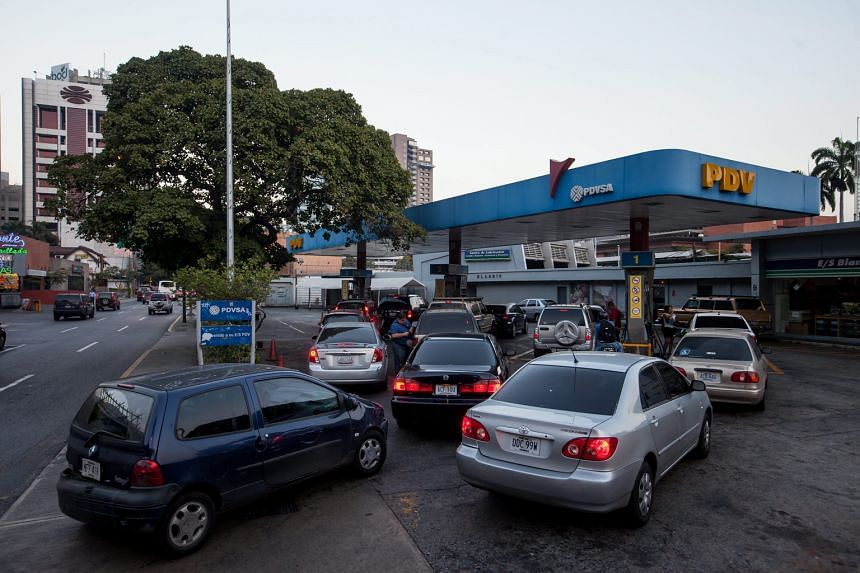 Queues formed at Venezuela's petrol stations before the 6,000 per cent price hike kicked in yesterday