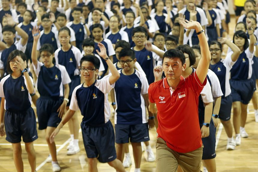 Minister of State for Health Chee Hong Tat (in red) joining students for an aerobics warm-up during the official launch of Rep With Steps held in Woodgrove Secondary School last Friday.