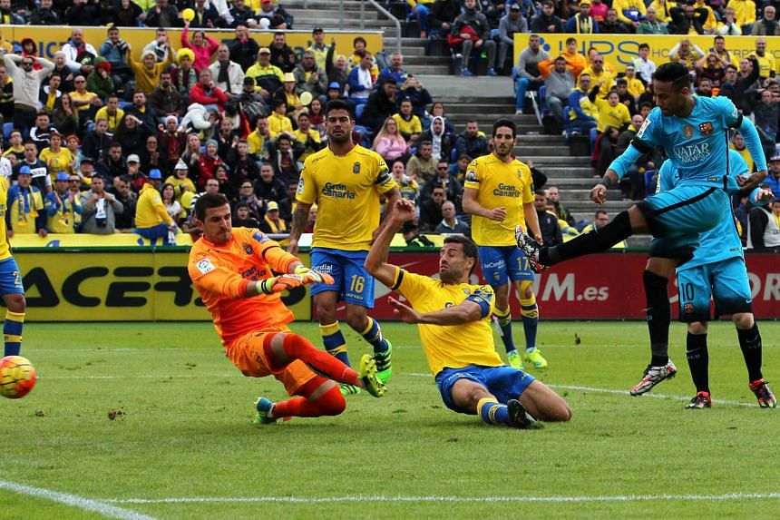 Barcelona forward Neymar putting his team back in front just before half-time against Las Palmas.