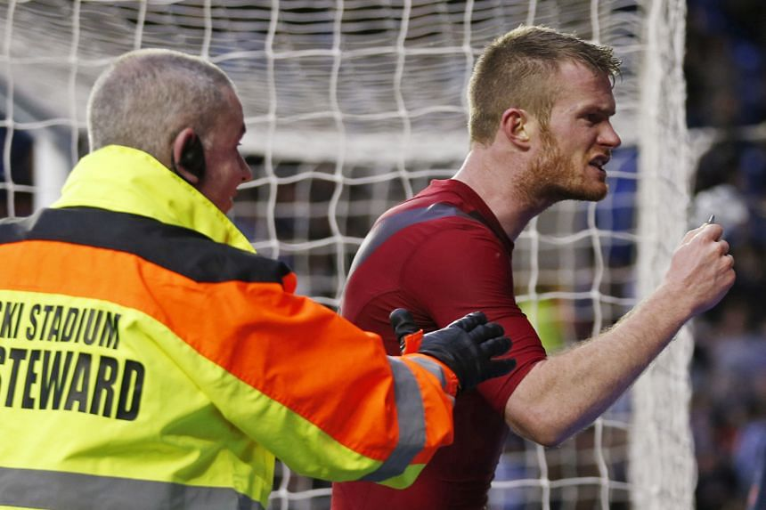 An angry Chris Brunt confronting his own team's fans after being hit by a coin.