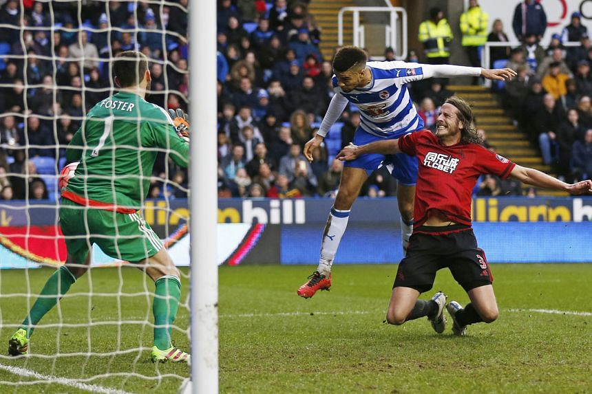 Left: Michael Hector, on loan from Chelsea, leaping to head home and give Reading a 2-1 lead over West Bromwich. The second-tier side, who reached the semi-finals last year, won the FA Cup fifth-round tie 3-1.