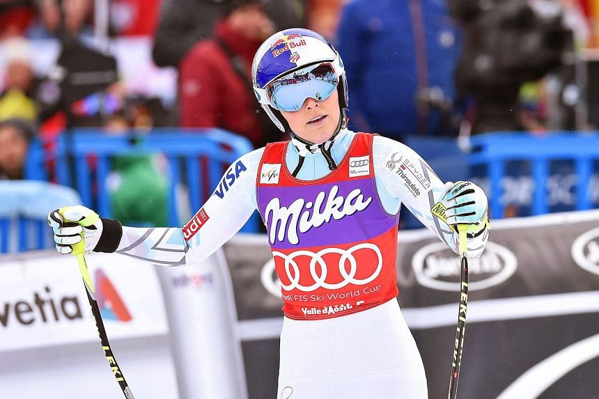 Lindsey Vonn of the US reacting after taking second place in the women's downhill race of the Alpine Skiing World Cup. She is now assured of a record eighth crown in the discipline.