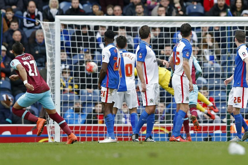 Dimitri Payet curling a free kick into the bottom corner in the 36th minute to make it 2-1 and put Premier League side West Ham in the lead for good in their FA Cup fifth-round tie at Blackburn Rovers last night. Ben Marshall opened the scoring in th