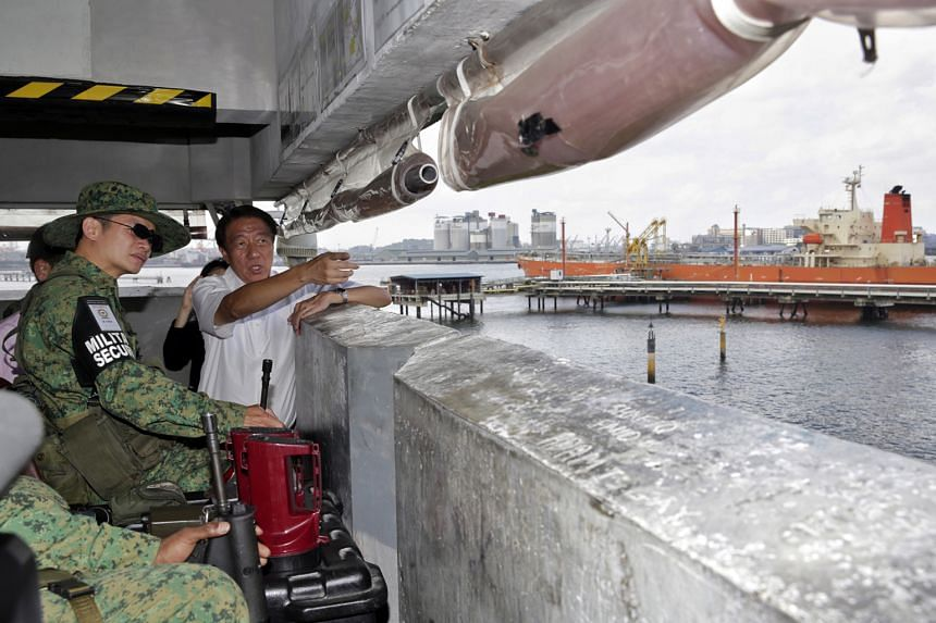 DPM Teo Chee Hean and Third Sergeant Chia Yong Guan, a 38-year-old security trooper, at an observation tower on Jurong Island yesterday. Mr Teo was visiting citizen soldiers deployed to patrol Jurong Island, the main location for the country's petroc