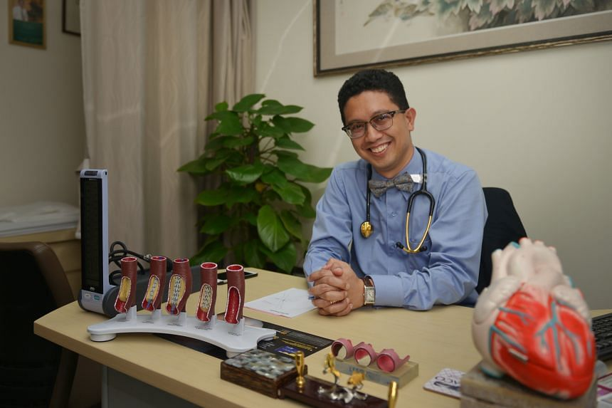 Cardiologist Abdul Razakjr Omar, seen here in his Raffles Hospital office, says common advice to prevent a heart attack like eating healthily, staying trim and exercising regularly may sound passe to some, but it works for many people.