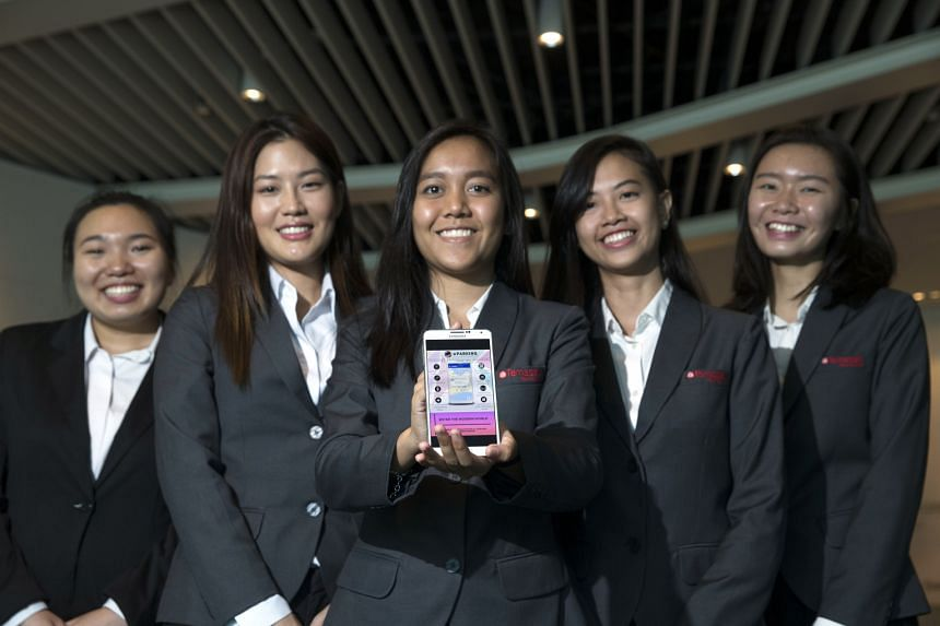 Temasek Polytechnic business information technology students (from left) Ye Xianmin, 20; Nittayawan Charoenkharungrueang, 22; Nur Raeesah Bte Abdul Mallik, 20; Nur Namirah Bte Anee, 20; and Jolene Tan, 19, with the eParking app they created. Their ap