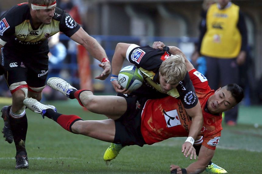 The Sunwolves' Akihito Yamada tackling the Lions' Jaco van der Walt yesterday in their Super Rugby opener in Tokyo. Despite a 26-13 defeat, the Japanese debutants acquitted themselves well.
