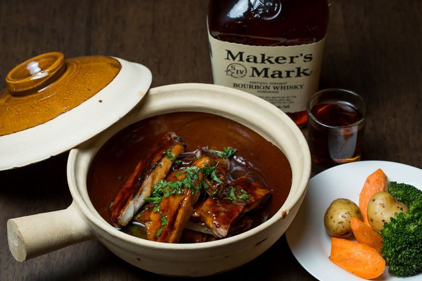 Chargrilled honey-glazed pork ribs flambeed with Maker's Mark Bourbon ($36)