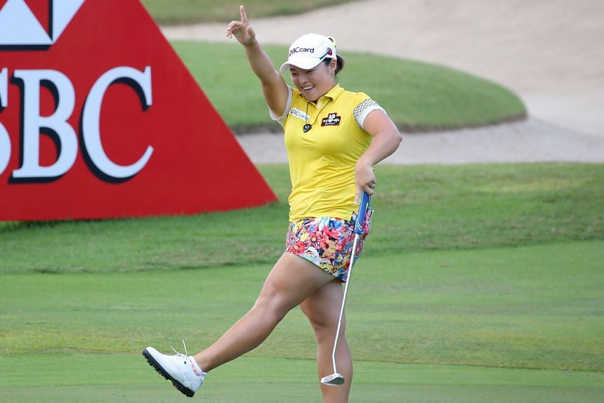 Jang Ha Na of South Korea does a victory dance after her final putt allowed her to emerge as winner of the HSBC Women's Champions by four shots at the Sentosa Golf Club.