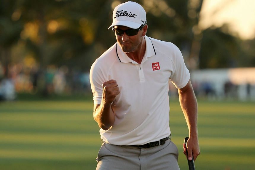Adam Scott reacting after putting in to win on the 18th hole during the final round of the WGC-Cadillac Championship.