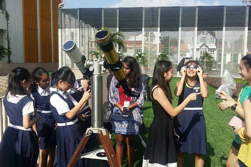 Students and teachers from Paya Lebar Methodist Girls' School (Secondary) participating in the solar observation programme. The students have been learning to observe the sun through the 11 solar telescopes set up in the school's sky garden since Feb