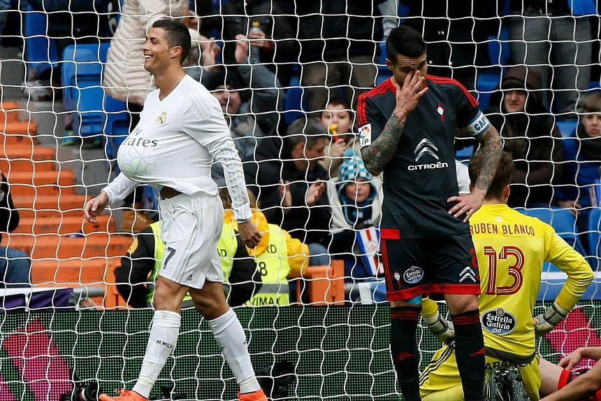 Real Madrid's Cristiano Ronaldo (left) in a jolly mood after scoring the third of four goals against Celta Vigo in the 7-1 La Liga win on Saturday. His team will be looking to defeat Roma today to book their place in the Champions League quarter-fina