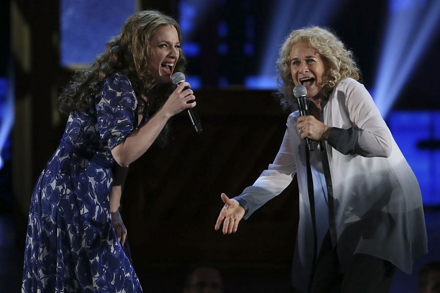 Carole King (far right), who soared to fame on her 1971 album Tapestry (above), performing with Jessie Mueller (right), who played King in Beautiful: The Carole King Musical, at the 68th annual Tony Awards in New York two years ago.