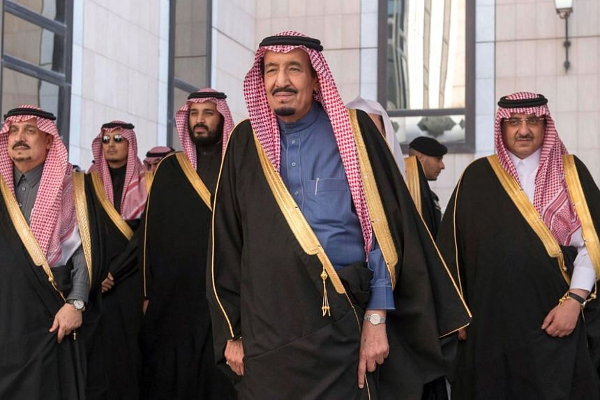 Saudi King Salman (centre) with some of his ministers and officials in Riyadh.