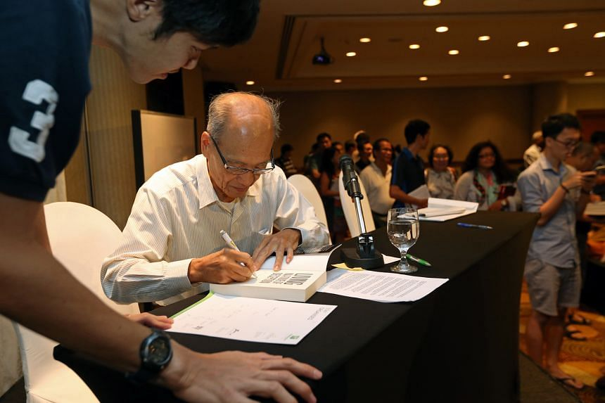 Dr Poh signing a copy of his book at the launch event on Feb 13.