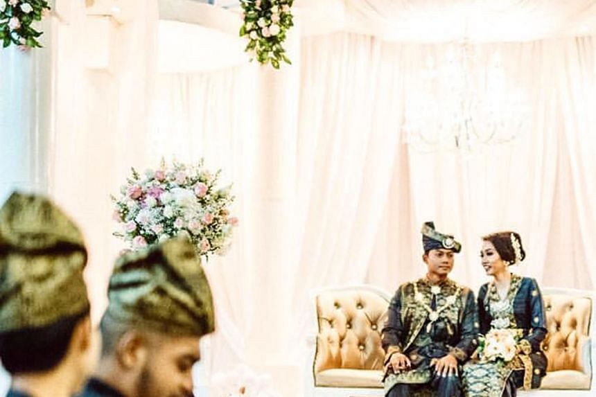 Mr Raizan and Ms Farhana held their wedding reception at Ulu Pandan Community Club on Jan 11. They were willing to spend more for air-conditioning plus they felt the void deck at their home was not ideal as space was limited, with obstructions like f