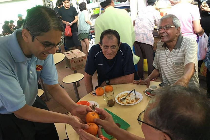 WP's Mr Leon Perera greeting residents at a hawker centre during Chinese New Year on Feb 6. The East Coast team says it started house visits much earlier this time than after GE2011.