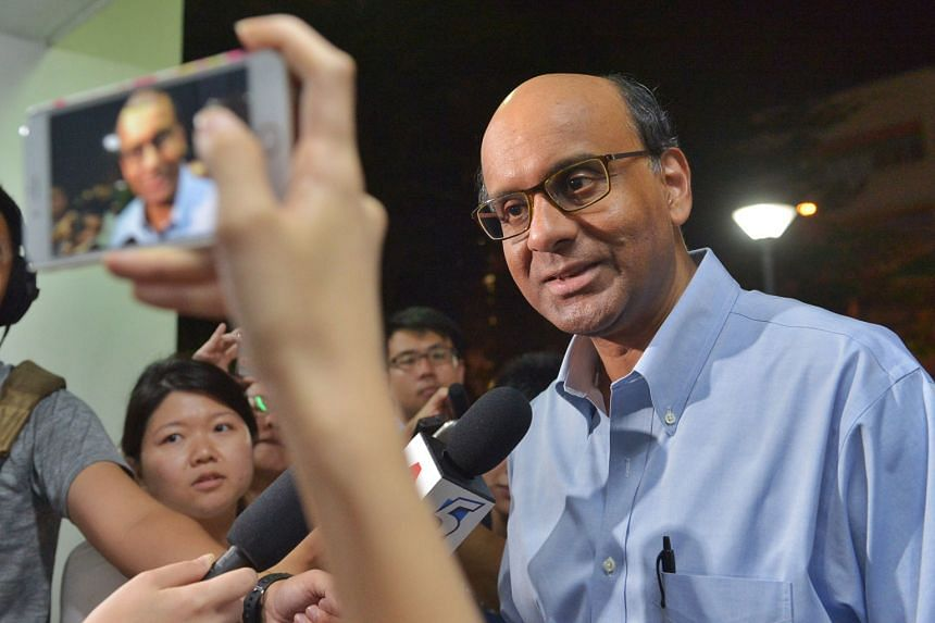 """Mr Tharman speaking to reporters in Bukit Batok, where he met residents at the Meet-the-People Session last night. He said that the PAP's candidate to replace Mr David Ong will be """"someone committed to the interest of Bukit Batok residents, and who w"""