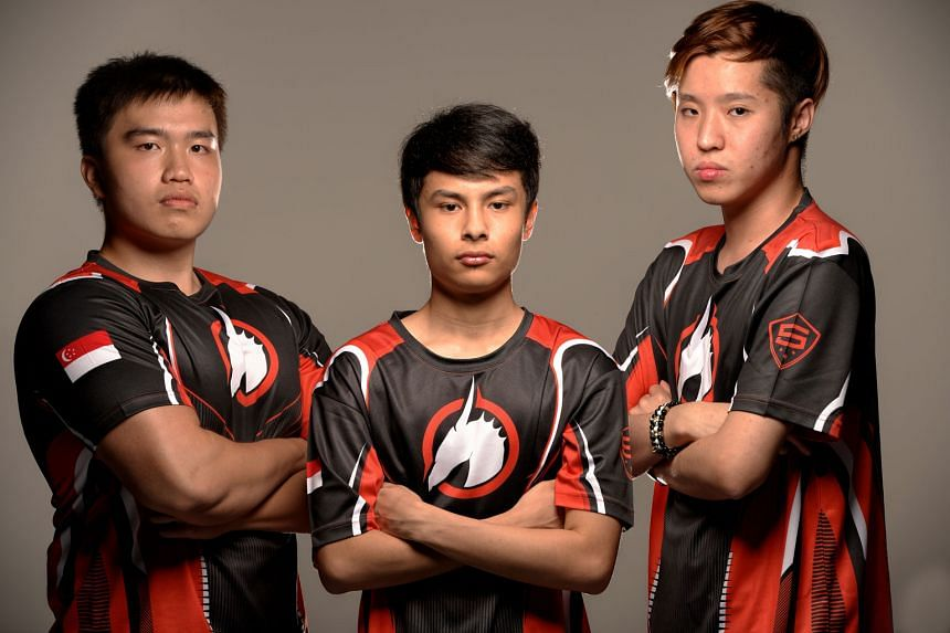 Singaporeans (from left) Joshua Lim, Juan Rodriguez and Amos Goh are members of local Halo team Skyfire. Together with Filipino Franciso Adriano, they will compete in this year's Halo World Championship in California. Mr Rodriguez is team captain and