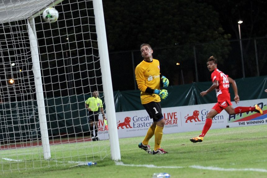 Young Lions goalkeeper Benjamin Bertrand looks on helplessly after Khairul Nizam's header loops over him into the net. After six games, the Young Lions are bottom of the table.