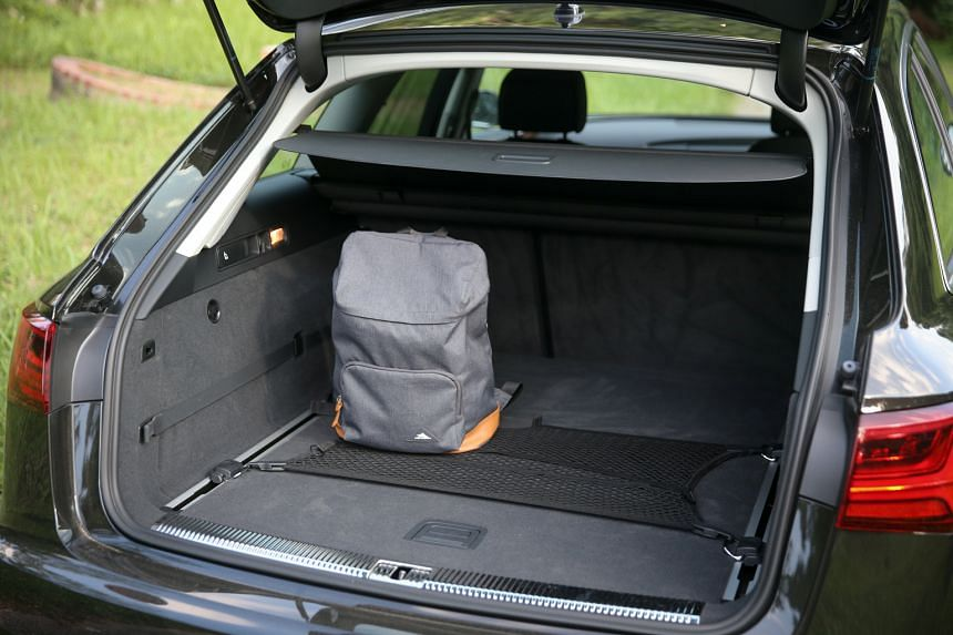 The Audi A6 Avant's squarish boot (above) allows you to stow things that can be laid flat but not those that stand tall.