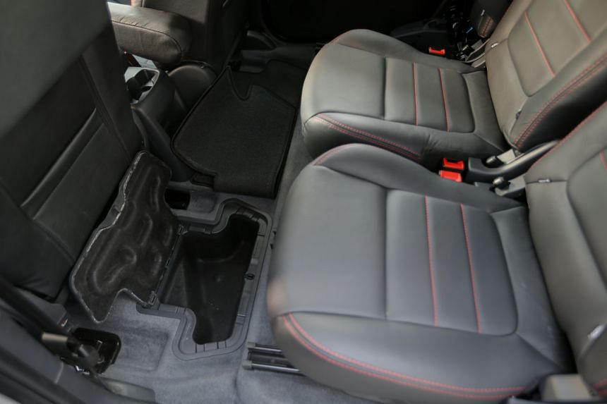 The Peugeot 5008 comes with details such as foldable back seats, dent-resistant plastic fenders, storage compartments in the floor (above) and head-up display.