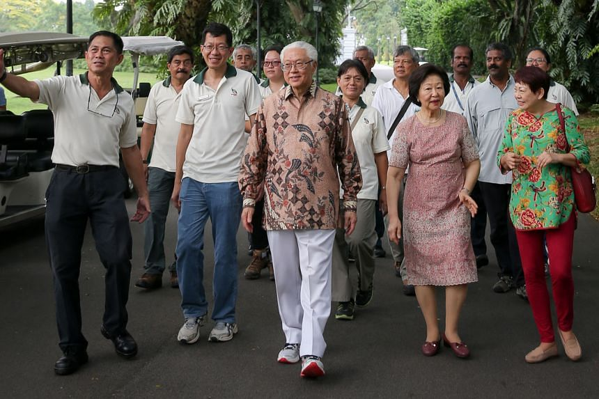 President Tan and Mrs Tan touring the Istana grounds, led by Mr Wong (far left), who shared in detail the late Mr Lee's involvement in various garden projects there.