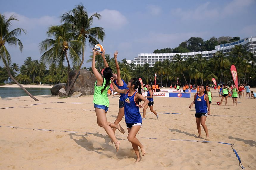 Netballers getting their kicks during the Mission Foods Beach Netball Festival at Siloso Beach on Sentosa yesterday. The event had its biggest turnout in seven years with 63 teams in five categories. Four-a-side games were played on a half court. In