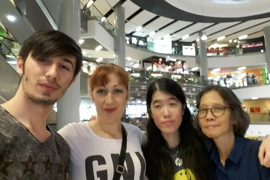 Ms Yap and her mother, Madam Foo, with Mr Donea and his mum Aurelia at a mall in Singapore. The Singaporean women, who were feared missing in Romania earlier this year, returned home two weeks ago.