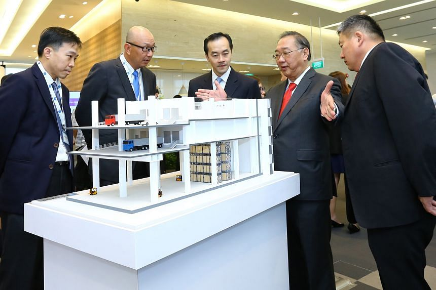 (From left) JTC chief executive Png Cheong Boon; Mr Leong Hong Yew, JTC's director (food & lifestyle cluster); Minister of State Koh Poh Koon; Mr George Huang, emeritus president of Singapore Manufacturing Federation; and Mr Thomas Pek, president of