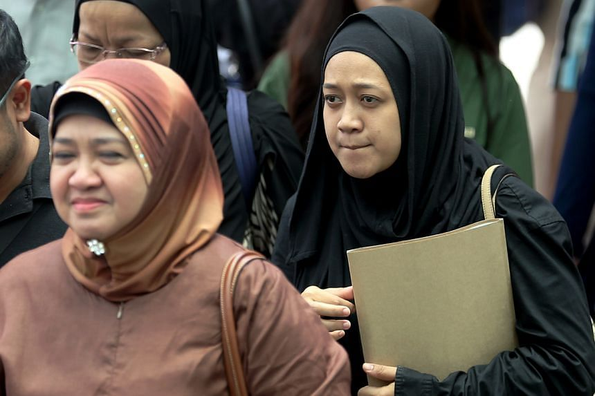 Ms Nurul Asyikin (above) and her mother put out the flames engulfing the younger woman's husband. He was in pain and bleeding, and could not see clearly or breathe properly.