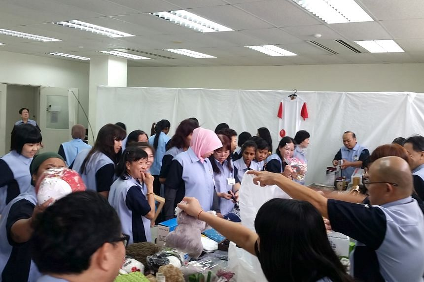 Tanaka Electronics staff at the flea market, which raised more than $5,300 for The Straits Times School Pocket Money Fund.