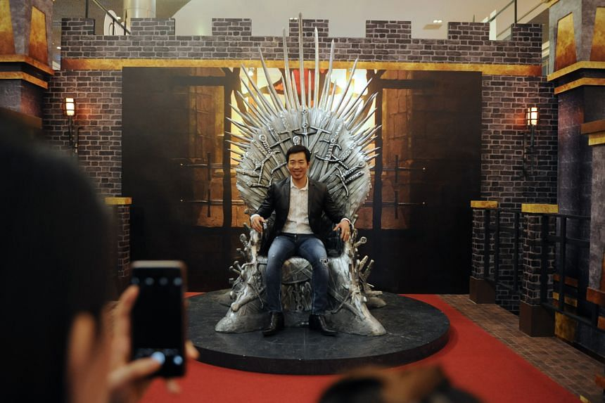 A life-sized replica of the Iron Throne (left) takes centre stage for photo opportunities in Ion Orchard. Above: The writer with the virtual reality headset.