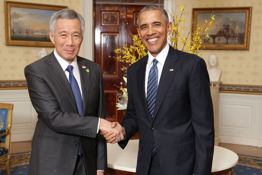 US President Barack Obama greeting Prime Minister Lee Hsien Loong in the Blue Room prior to a working dinner with Nuclear Security Summit heads of delegations in the East Room of the White House on Thursday.