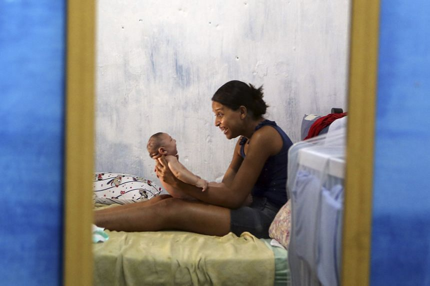 Ms Daniele Santos playing with her baby Juan Pedro, who has microcephaly, in Recife, Brazil. It is the hardest hit country in the Zika outbreak.