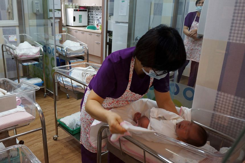 A nurse attending to a baby at the postnatal centre in Haenam General Hospital, in South Korea. The country's total fertility rate was 1.21 in 2014, similar to Singapore's 1.25 that year.