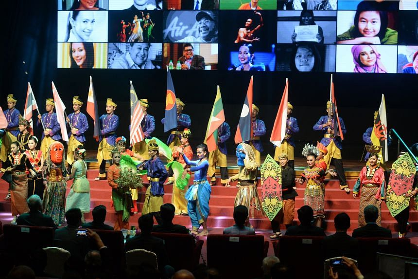 Malaysian dancers from various ethnic groups performing at the opening ceremony of the 26th Asean Summit in Kuala Lumpur last year. The newly declared Asean Economic Community will create jobs and open up a market worth $3.4 trillion and with more th