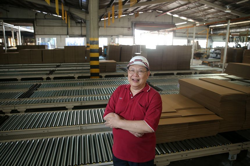 """Mr Ho has worked at TCG Rengo, where he oversees the production of cardboard packaging, for more than 30 years. He hopes to continue doing so for """"as long as my body says yes""""."""